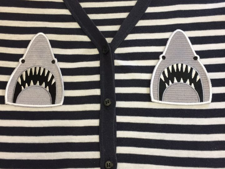 Jaws sew on patches.